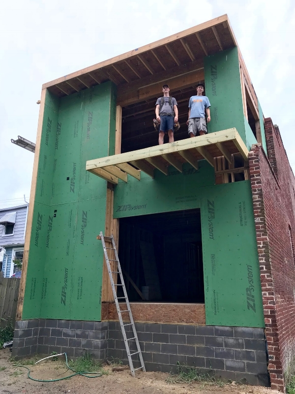 Pat (left) and Hunter showing off the balcony on our newly framed Church Hill addition.