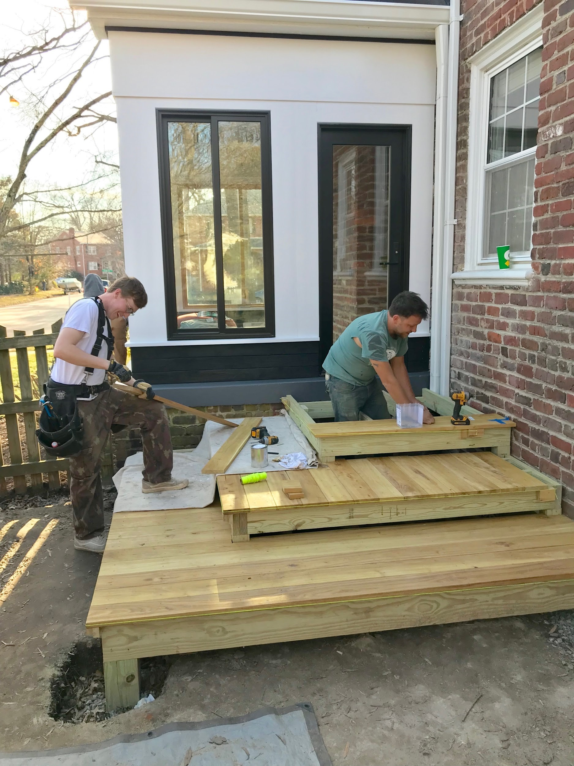 The RIC design build crew (Hunter and Nate) installing black locust decking