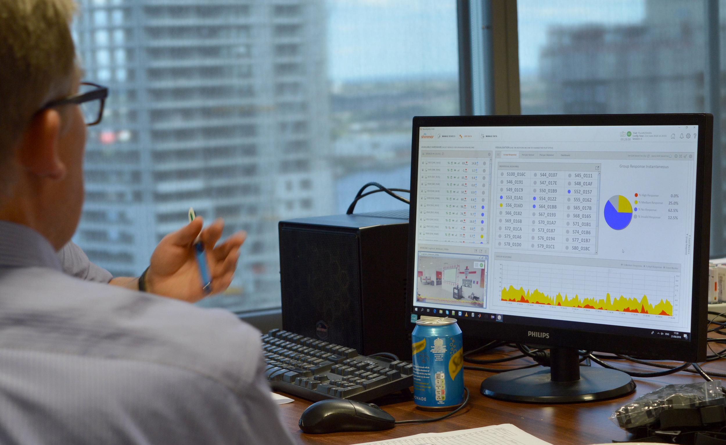 Geoff-Looking-at-NeuroLynQ-Screen.jpg
