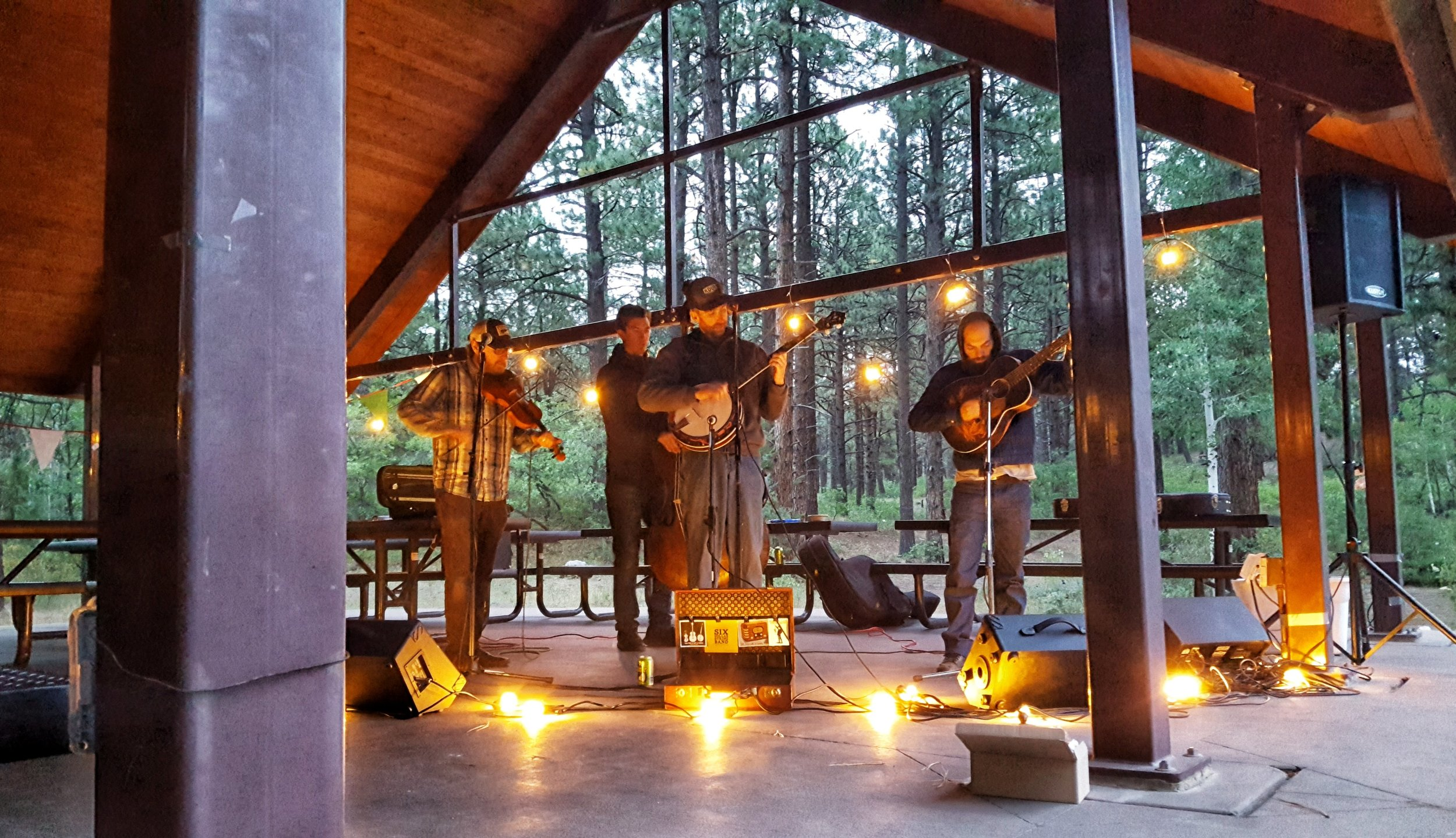 Six Dollar String band finished their act playing under a starry sky and next to a blazing campfire!