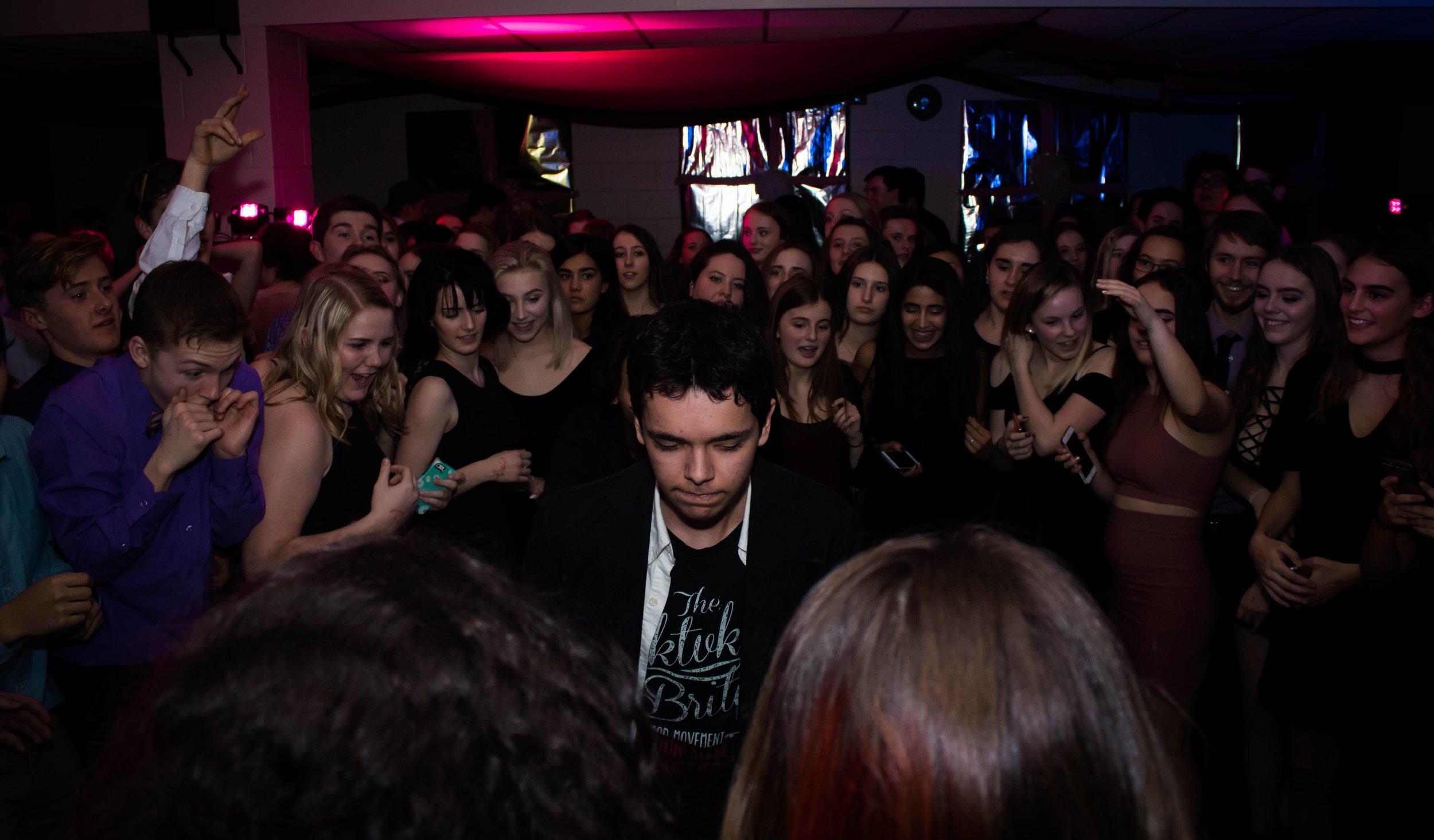 man in room full of people
