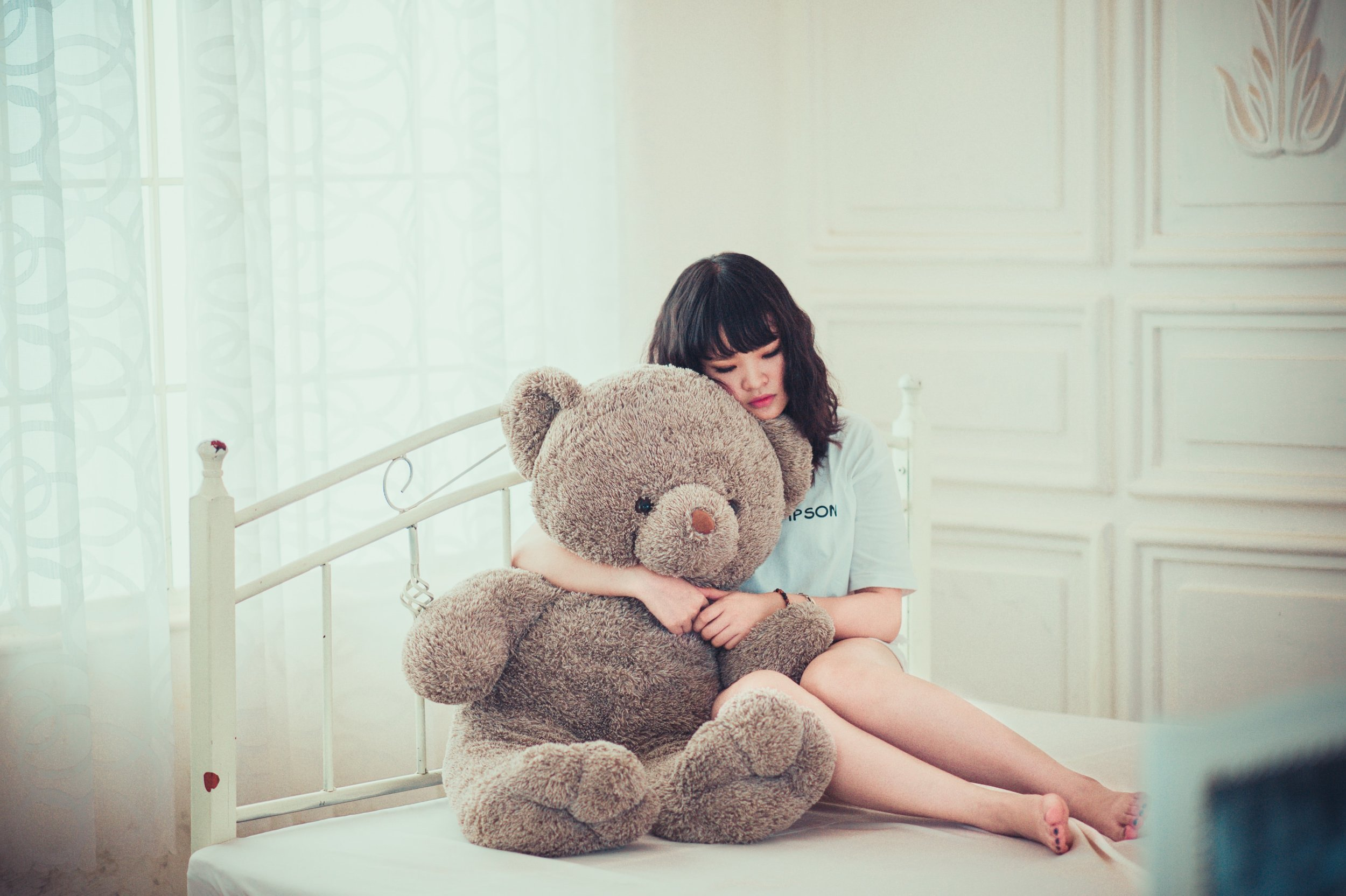 Girl Cuddling with Stuffed Bear