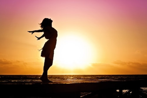 woman silhouette in sun