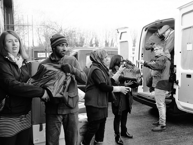 Volunteers helping to load vans for our third aid convoy to the Calais and Dunkirk refugee camps in February 2016.