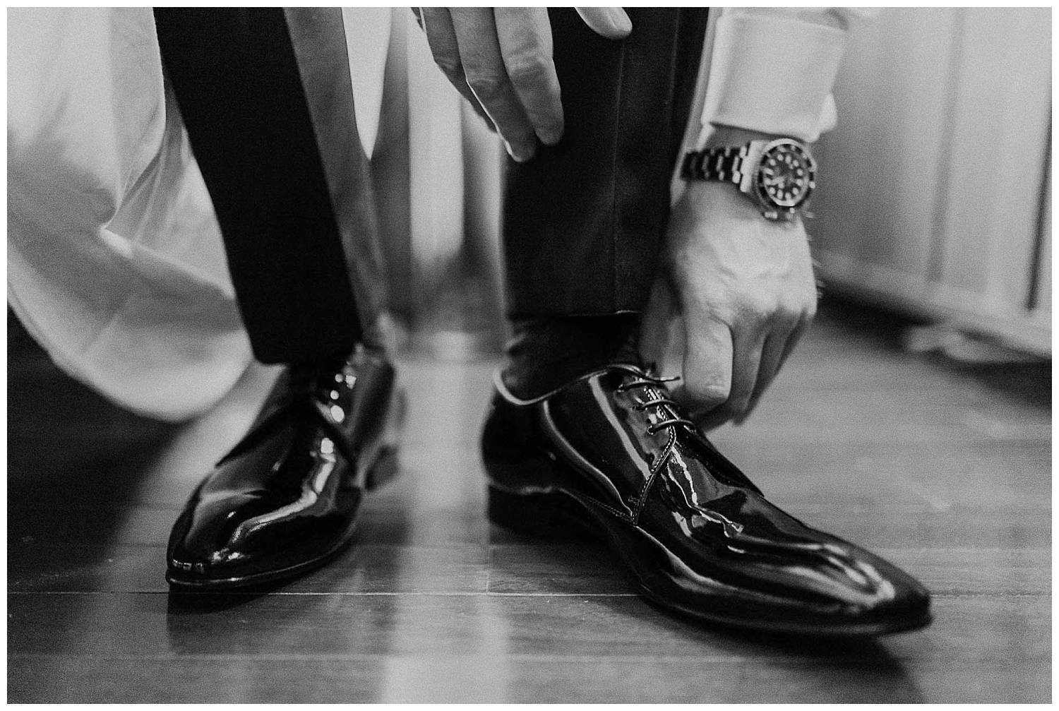 Groom-putting-on-his-shoes