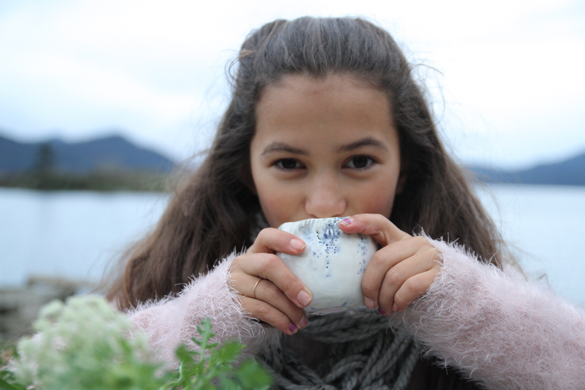 Isabella enjoying a warm cup of tea at our winter picnic. Photo by Gray G.
