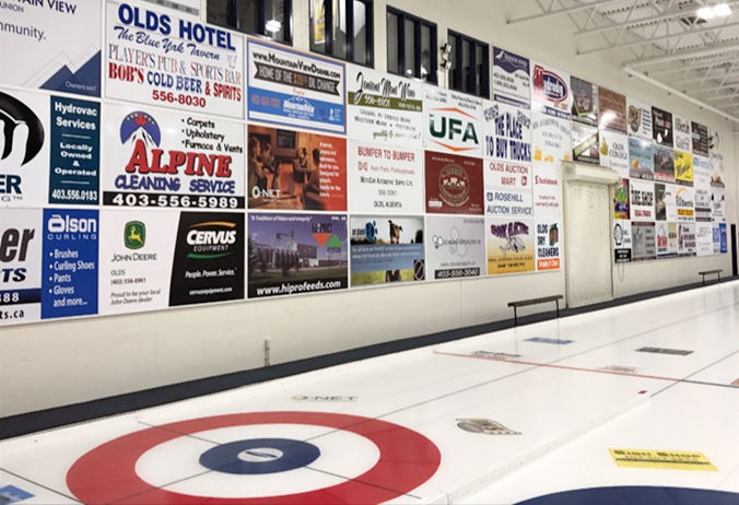 In Olds, there is now a waiting list for companies wanting to advertise inside the rink, after lighting upgrades made it possible for the facility to host international events.