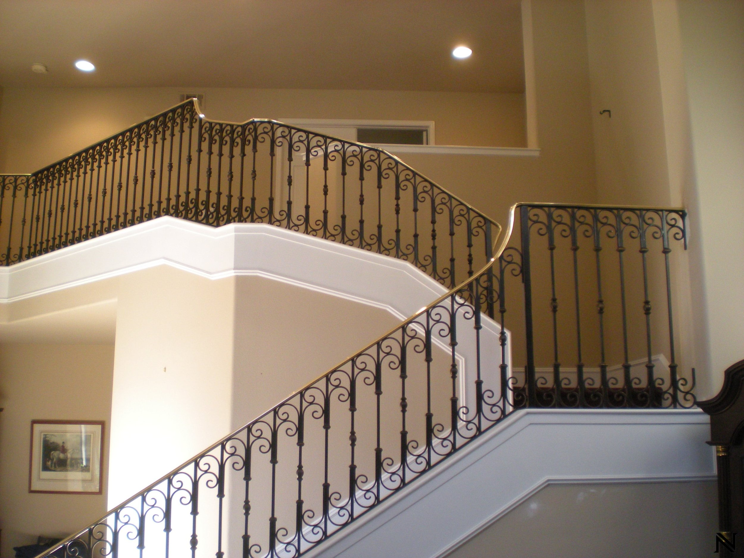 Vertical Banisters with Spiral Accents and Golden HandrailStaircase Railings Design Ideas Naddour's Custom Metalworks