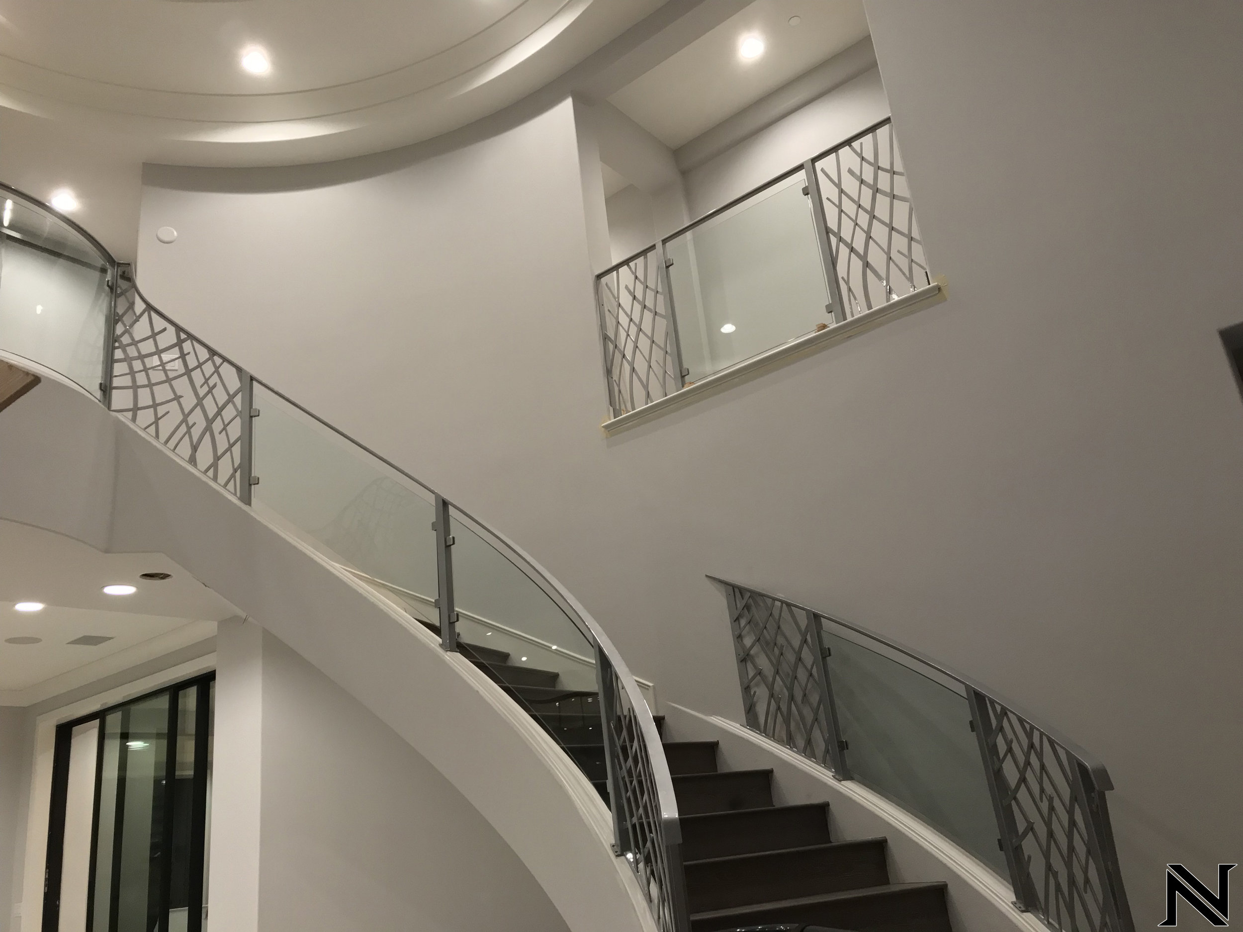 Metallic 'Loose Meshwork' Railings with Sleek HandrailStaircase Railings Design Ideas Naddour's Custom Metalworks