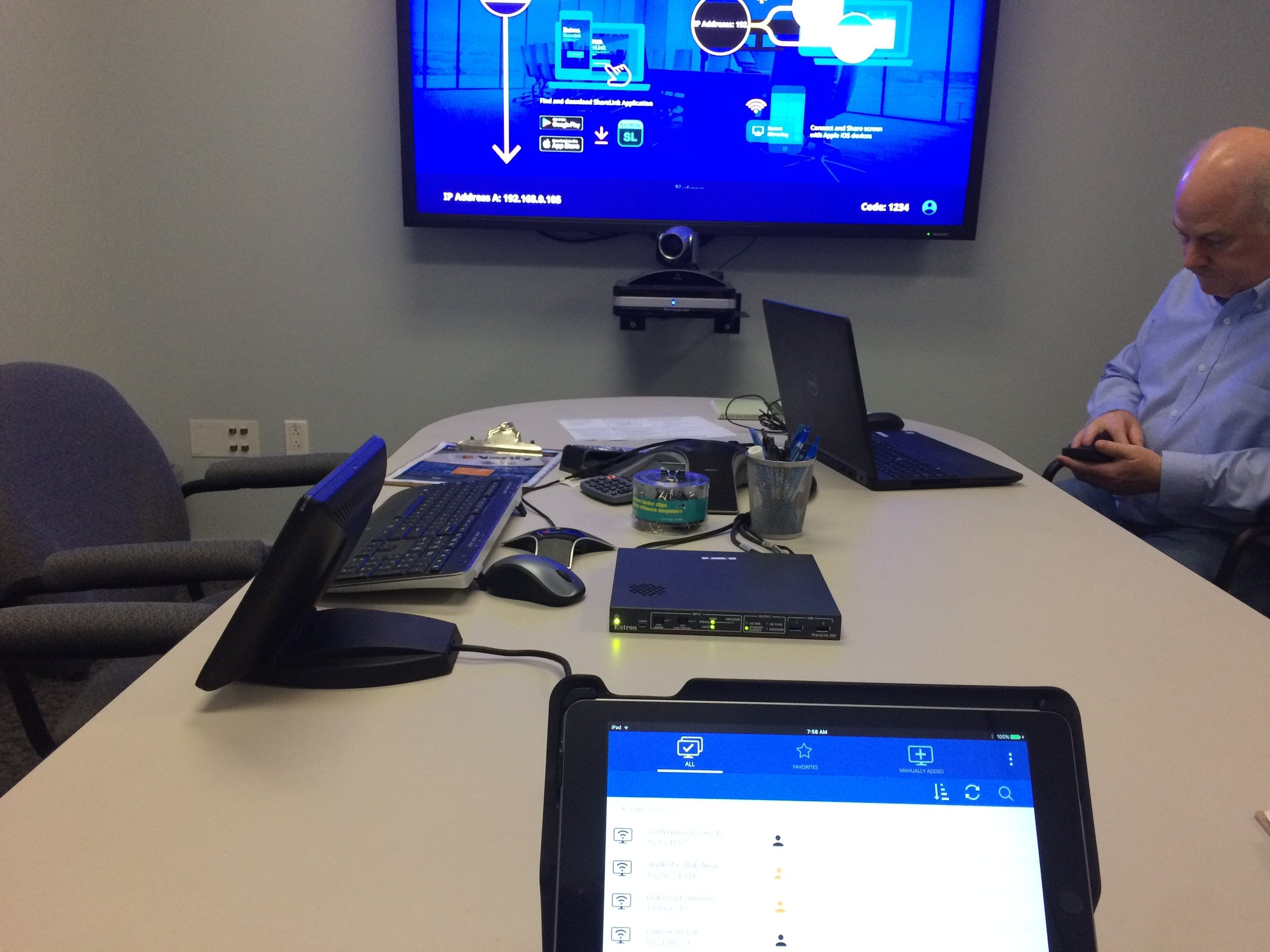 Perspective of a user testing the software. Once connected to a ShareLink device users can choose to share content to show on the large display in a room.