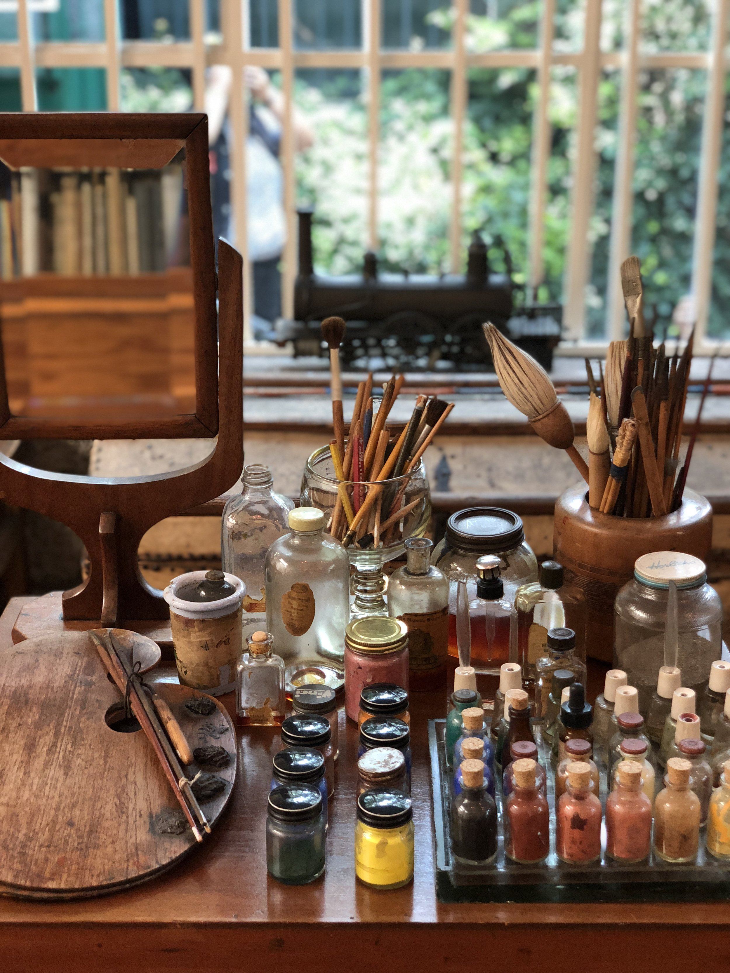 Perfume flasks and varnish jars which Frida used to hold her paint. Just as how she left it.