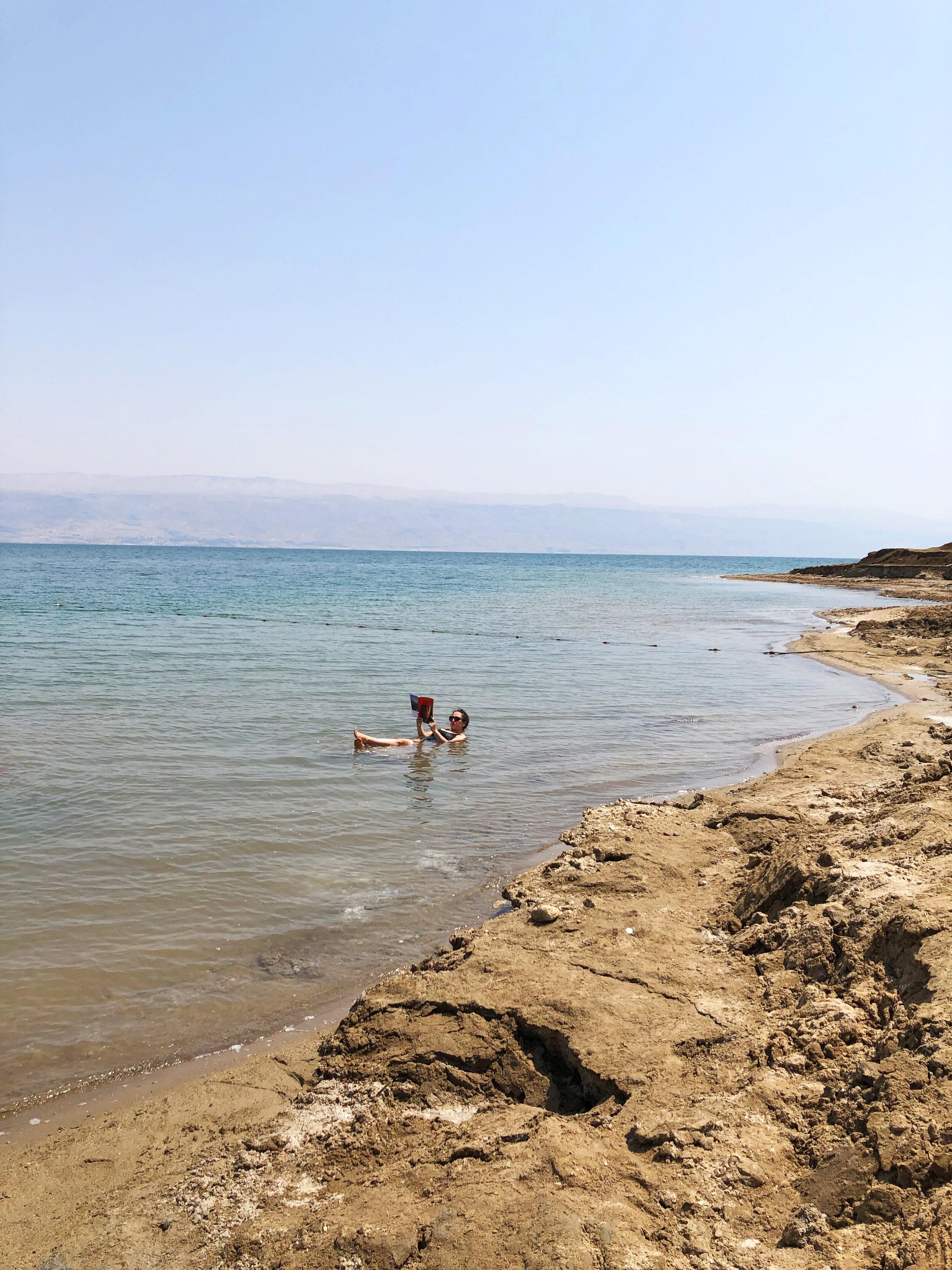 Reading my feminist pop-culture magazine in the Dead Sea.