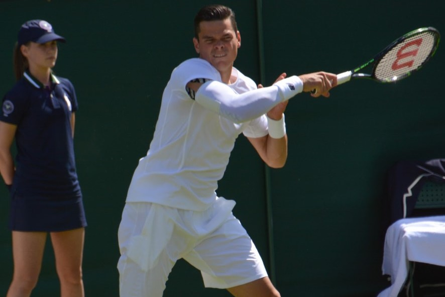 Milos Raonic wearing a compression sleeve at Wimbledon 2014