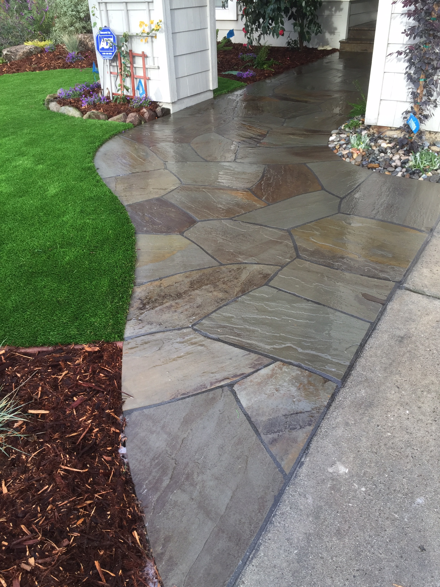 Flagstone Overlay Entry and Artificial Turf.JPG