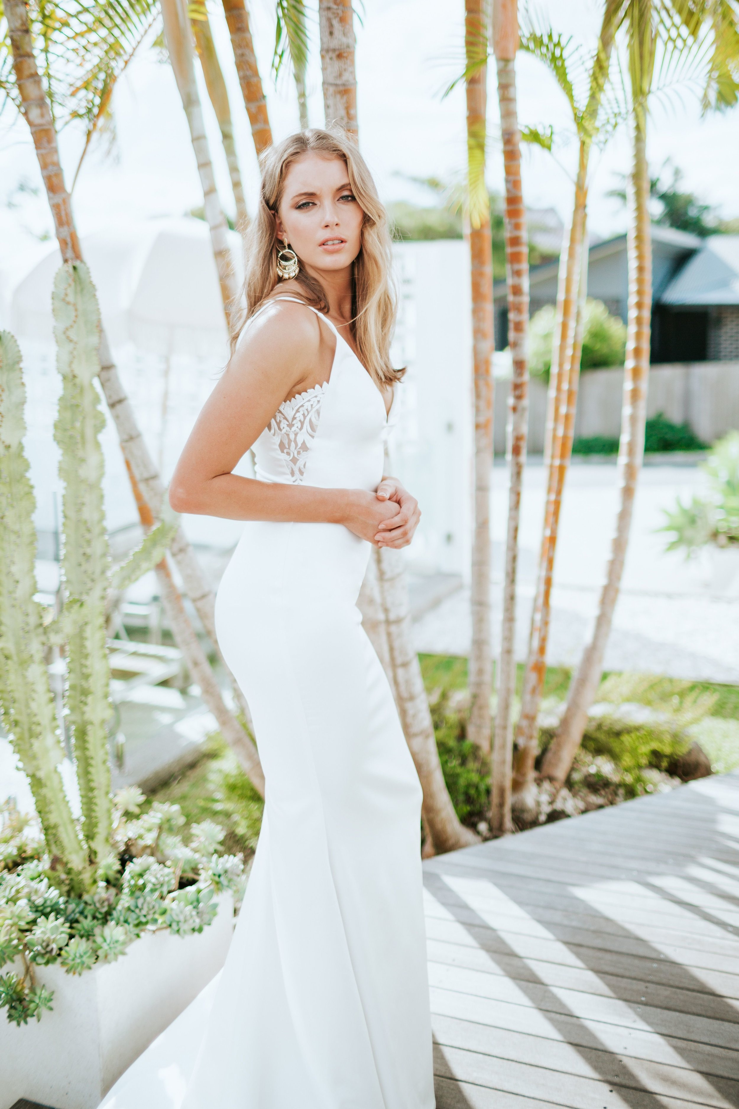 Our NEW YORK gown was designed to highlight the sexy silhouette of a modern, minimalistic bride. Made using a smooth ivory French crepe with silky finish, a v-neckline flatters from the front and lace detail compliments the bodice from the side.
