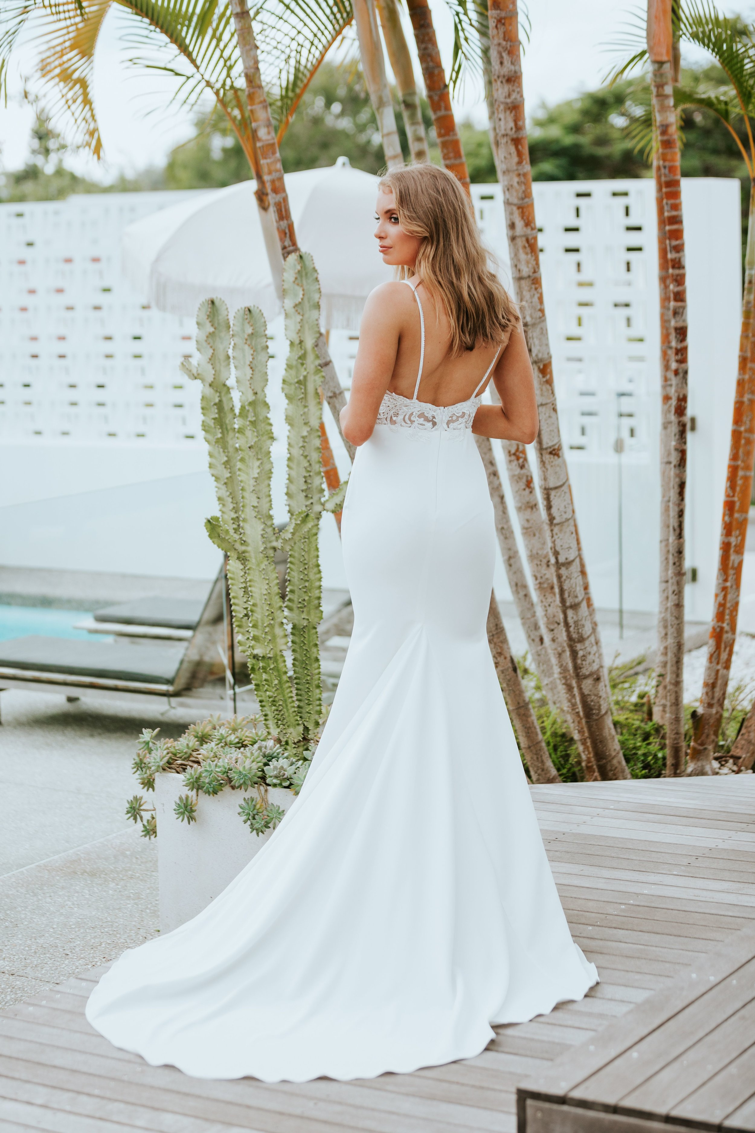 The CAPRI gown was made using a sparkling sequin and lace applique, hand-sewn onto the bodice for a unique luxe look. CAPRI is a divine gown that highlights your natural curves, hugging the hips with a soft, smooth matte French crepe.