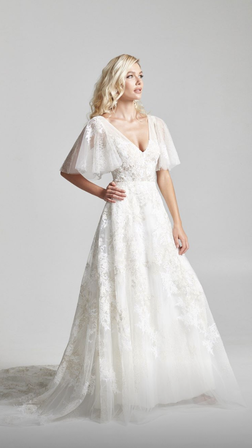 Rebecca Schoneveld 2020 bridal collection is available at Arizona Bridal Shop, Neue Bride in Mesa, Arizona! Come shop for modern wedding dresses like the Paloma A-line gown with flutter sleeve and beautiful intricately embroidered train.