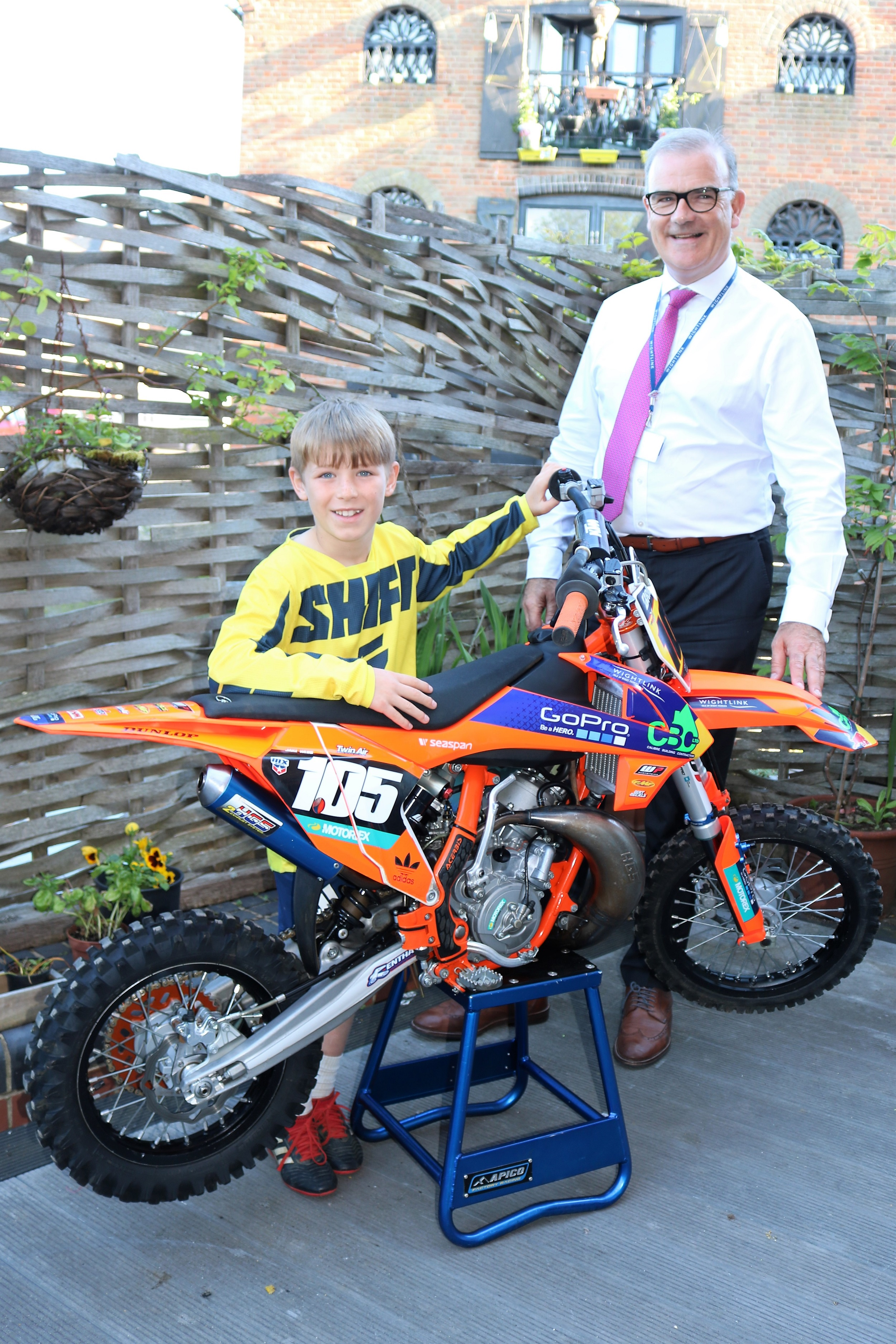 Nine year old motocross rider Jake Webb with Wightlink Chief Executive Keith Greenfield