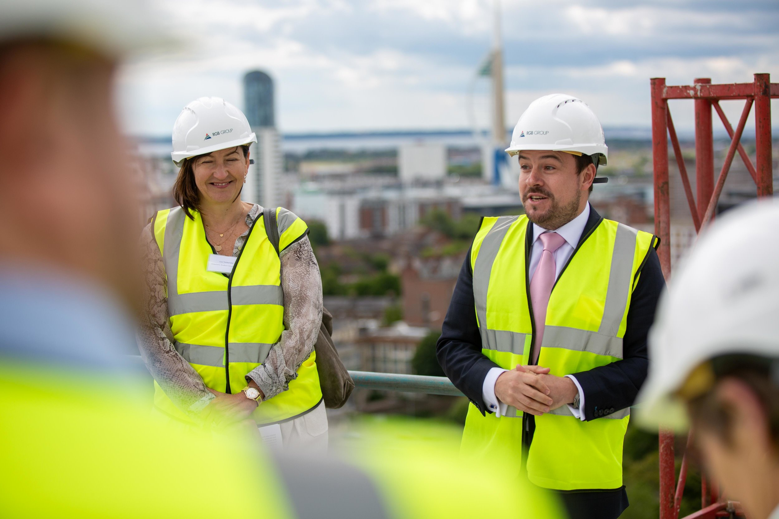 Lisa Timberlake, Senior Development Manager, Crosslane Student Developments and Neil Russell, Managing Director, RGB Group announcing the topping out atop Stanhope House