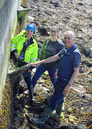 Wightlink Environmental Officer Nicola Craig with Jessica Bone and Dr Roger Herbert from Bournemouth University at the Vertipools near Bouldnor on the Isle of Wight