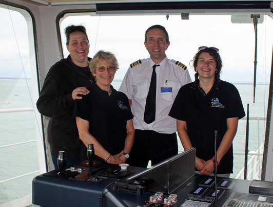 ORCA volunteers on board Victoria of Wight to survey the Solent with Captain Dave Booker L-R Emma Howe-Andrews, Jo Jaeckel, Captain Dave Booker and Katie Rapson