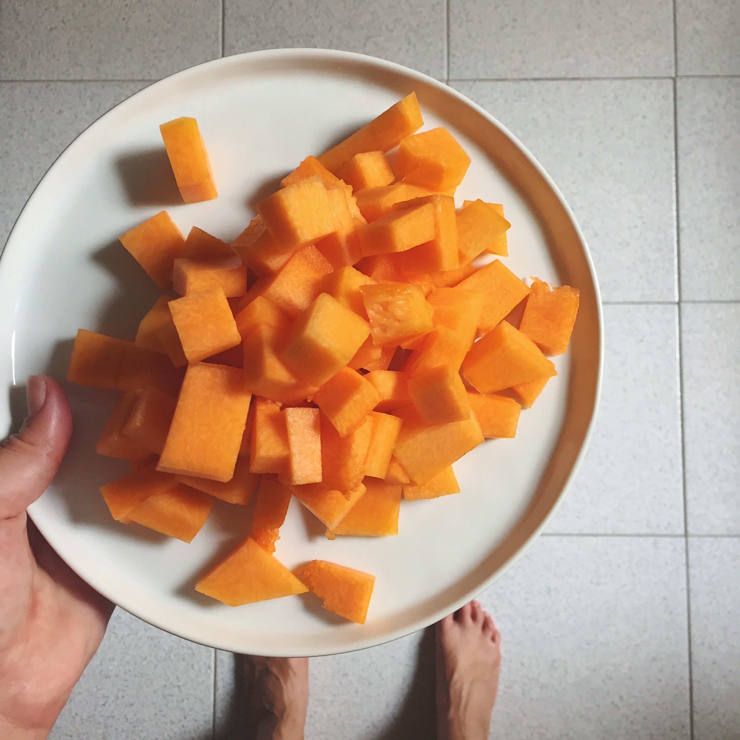 4. Prep zucca - Remove the skin, rinse and chop the zucca into roughly 1/2 inch cubes. Add to sauté pan and cook with onions for roughly 15 minutes, covered, stirring occasionally. Season with a pinch or two of salt.