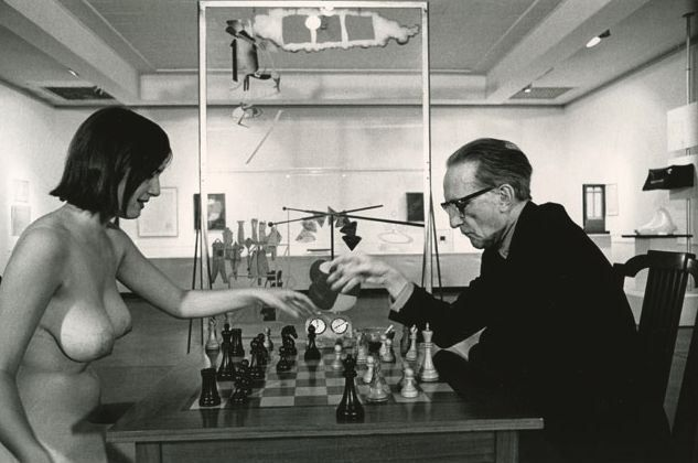 Eve plays chess nude with Marcel Duchamp