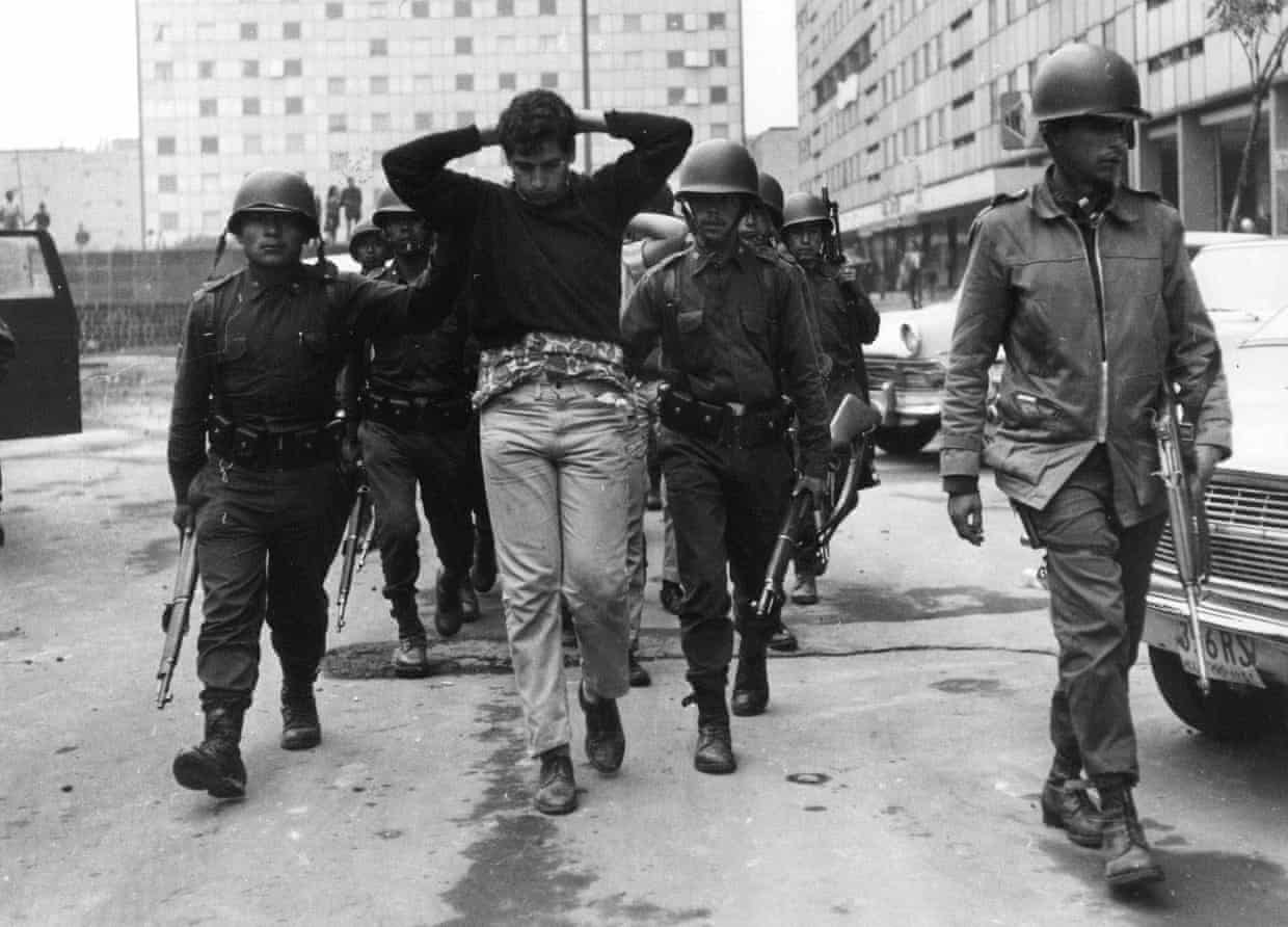 Mexican army troops escort demonstrators who were arrested during the Tlateloco protests which occurred on October 2nd, 1968. AP.