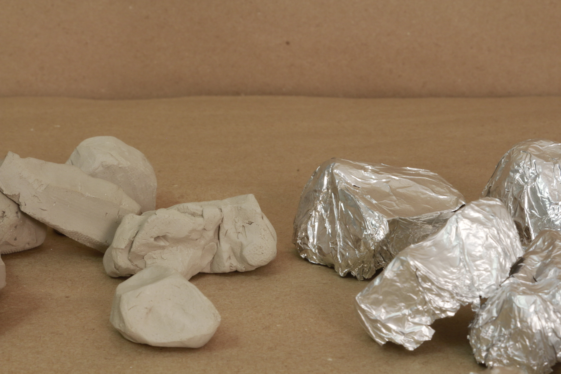 between rocks and a hard place - (2017-18) A on-going hobby of collecting rocks, sculpting the rock out of earth clay and casting the rock with tin foil.