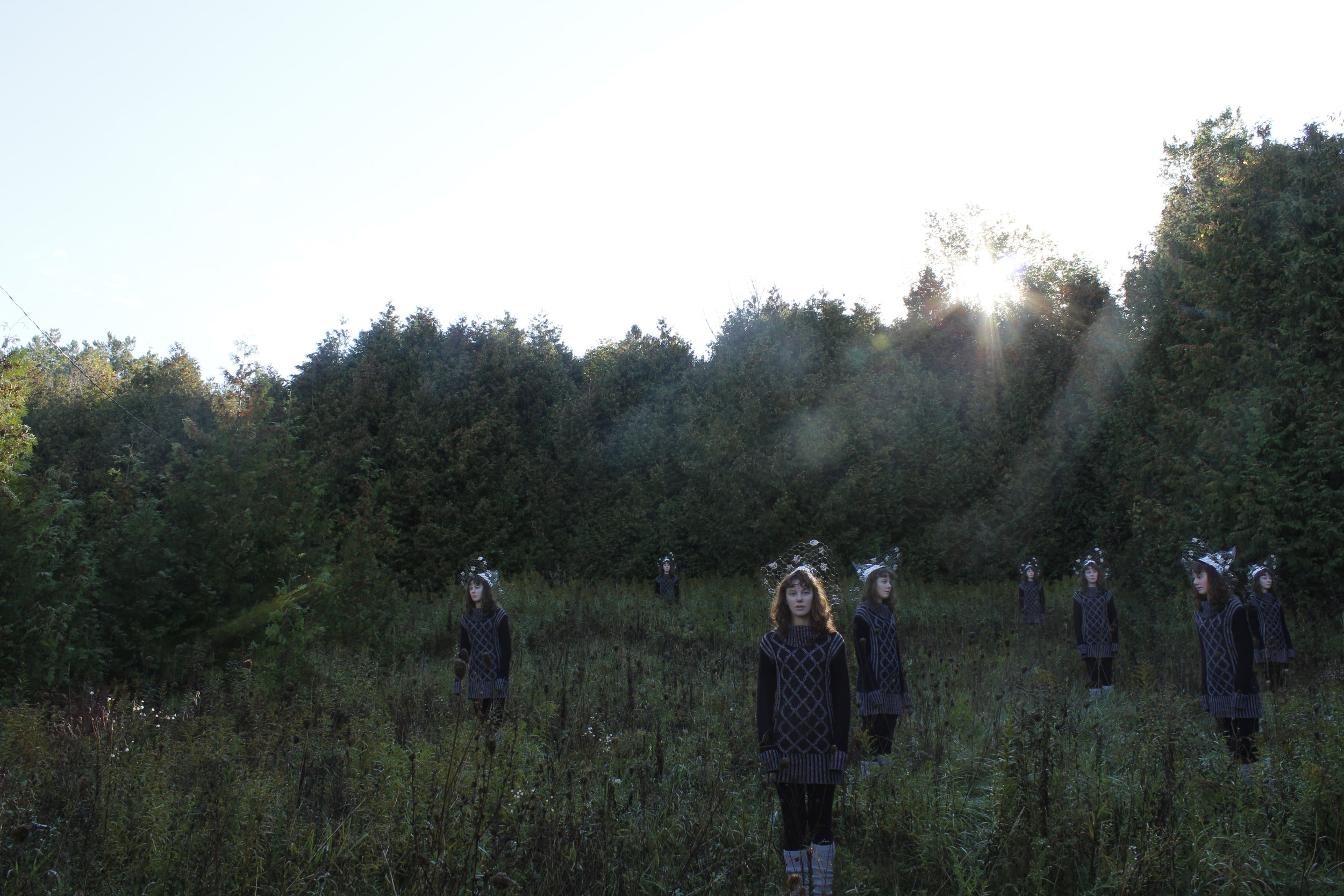 Toil&Foil - Toil & Foil (2017) is a site specific set of performative photographs taken at Island Lake Conservation Area in Orangeville, Ontario and at Forks of the Credit Creek in Caledon, Ontario. Taking a hand-made tin-foil witch hat to these rural landscapes creates an uncanny valley effect. The lonesome figure is multiplied, creating doppelgangers. The photographs play between the staged and unstaged, the real and fake, the humorous and the lonely.
