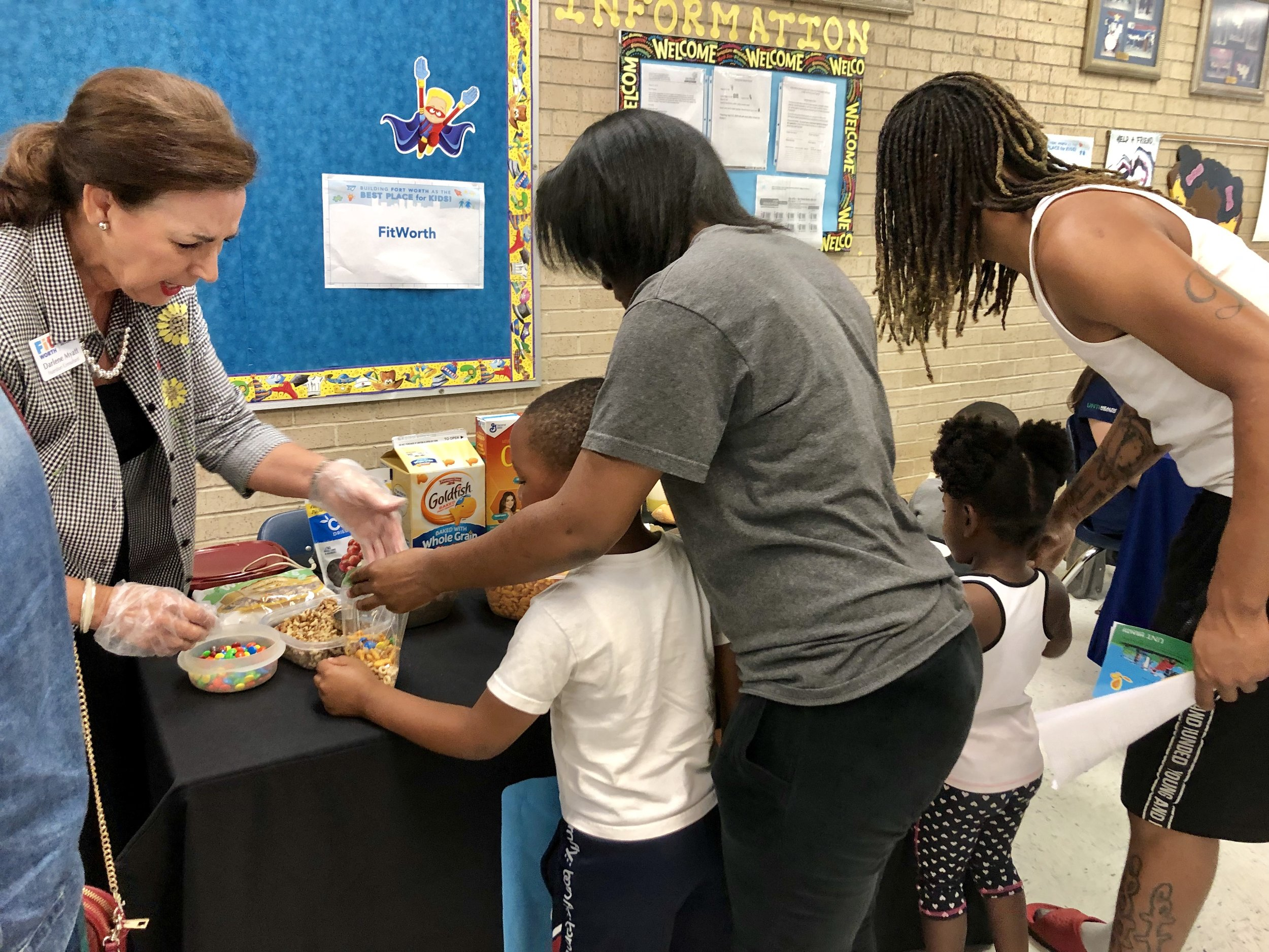Families learn how to make healthy snacks with FitWorth.