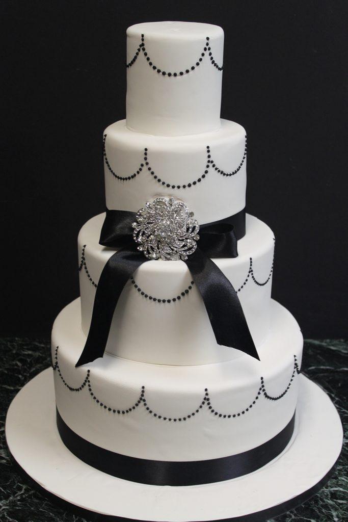 Black Swag & Bow Wedding Cake