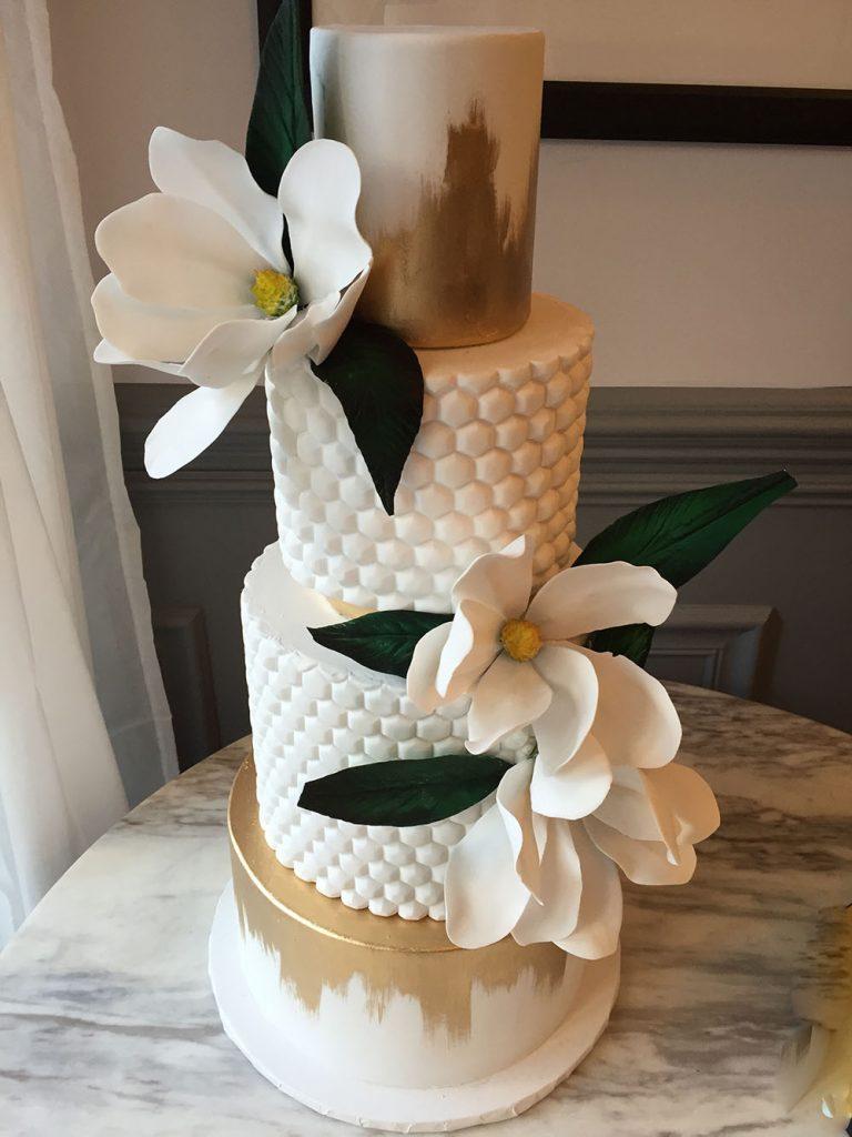 Gold and White Magnolia Wedding Cake