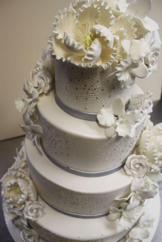 Peony Cascade & Silver Bands Wedding Cake