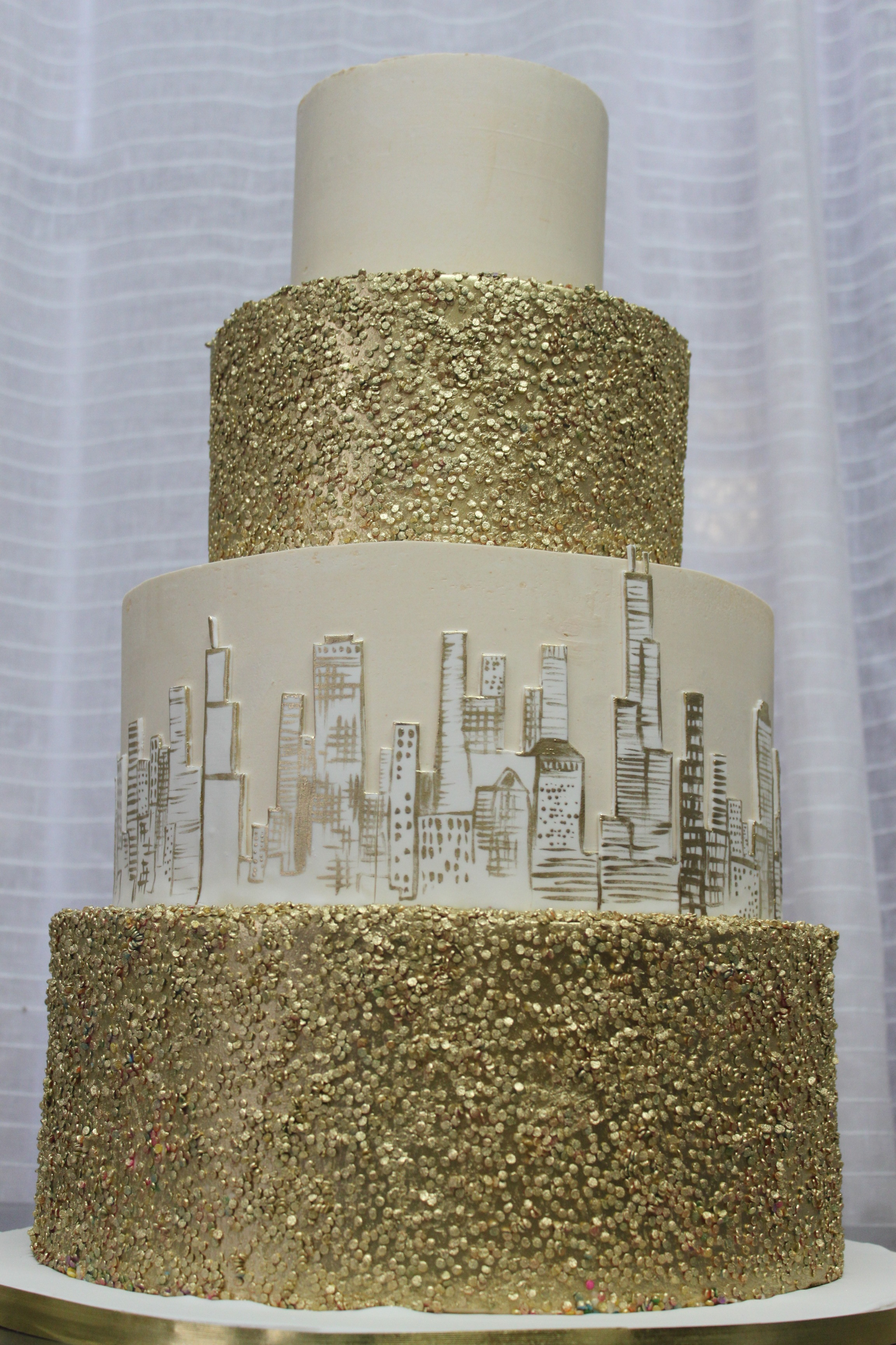 Gold Confetti & Skyline Wedding Cake