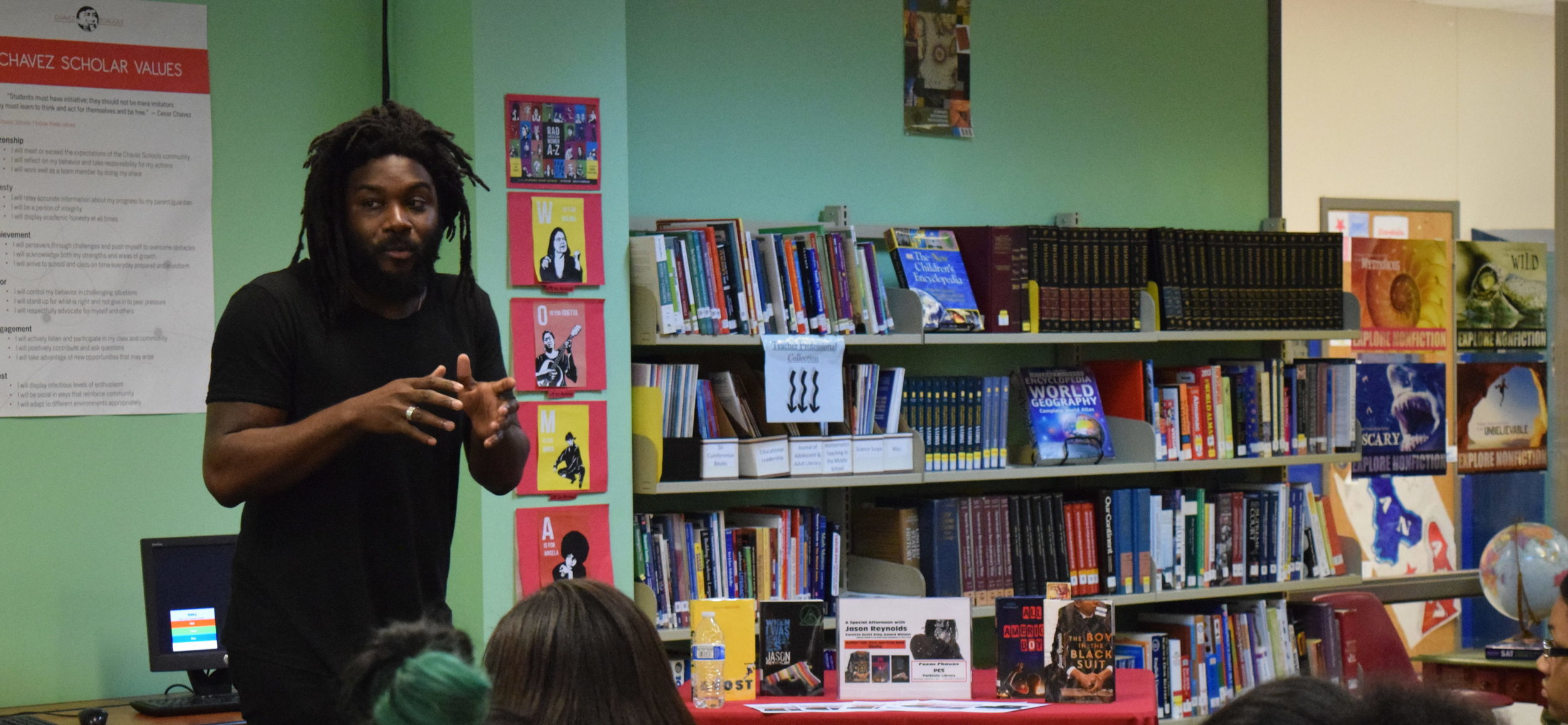 Washington-DC-Jason-Reynolds-author-giving-presentation-2-e1511196848414-4096x1894.jpg