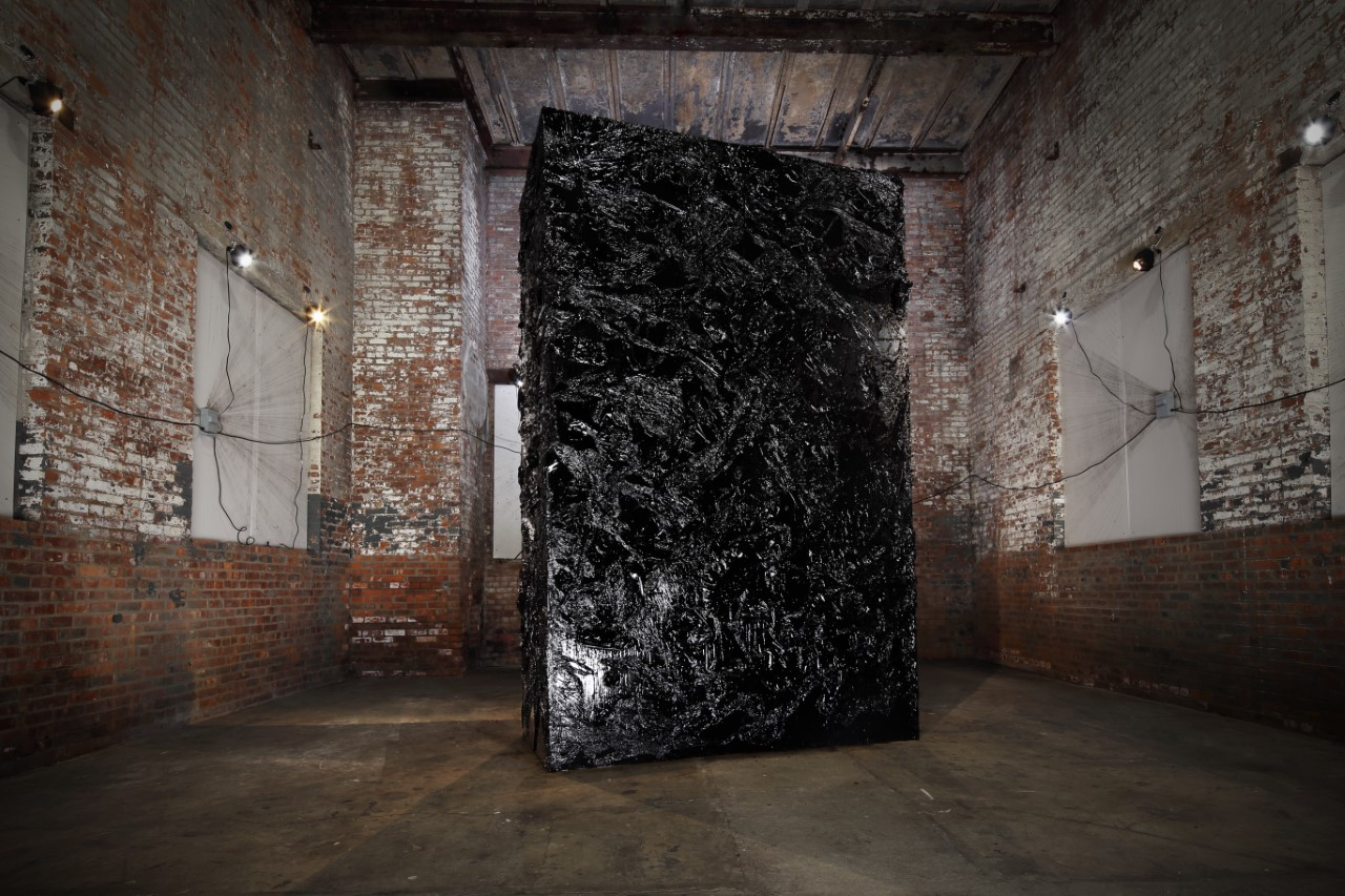 Atsunobu Kohira  wworks with coal -- he actually extracted from the pollution in the creek in their backyard to make this giant sculpture: