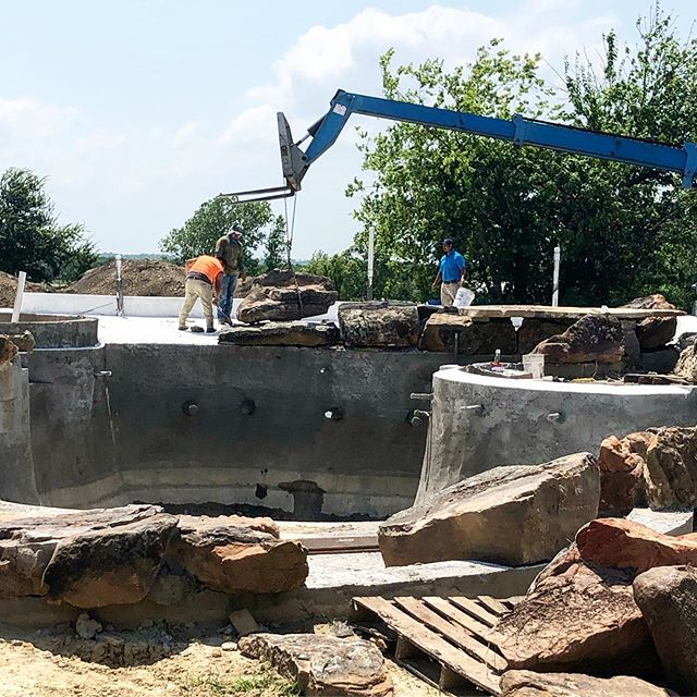 Just a couple of masons constructing a 100 ton waterfall on our lake pool! #lakepool #poolbuilder #waterfall #grotto #outdoors #boulders #pooldesign #poolman #rockwall #forney #texaspools