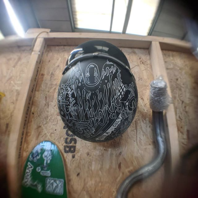 A hand illustrated open-faced helmet hanging in the workshop by @ollieplace. . . . . #illustration #atgatt #motoart #drawing #ink #builtinbrighton