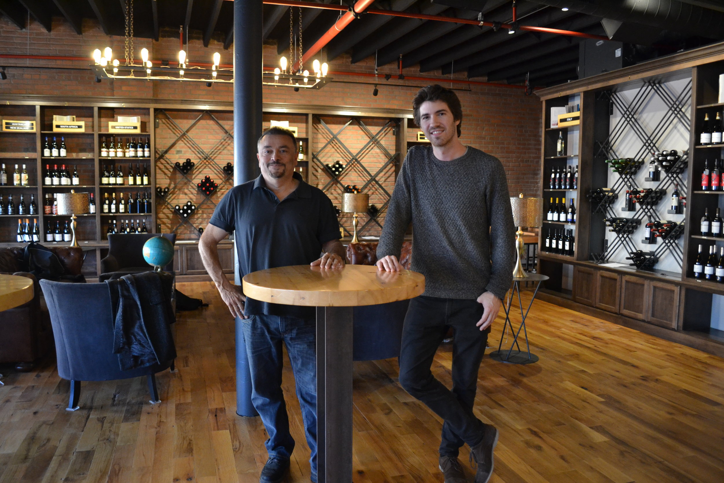 Anthony DiCio, Owner, and Bruno Leca, General Manager, in the Pennsylvania Market's wine library