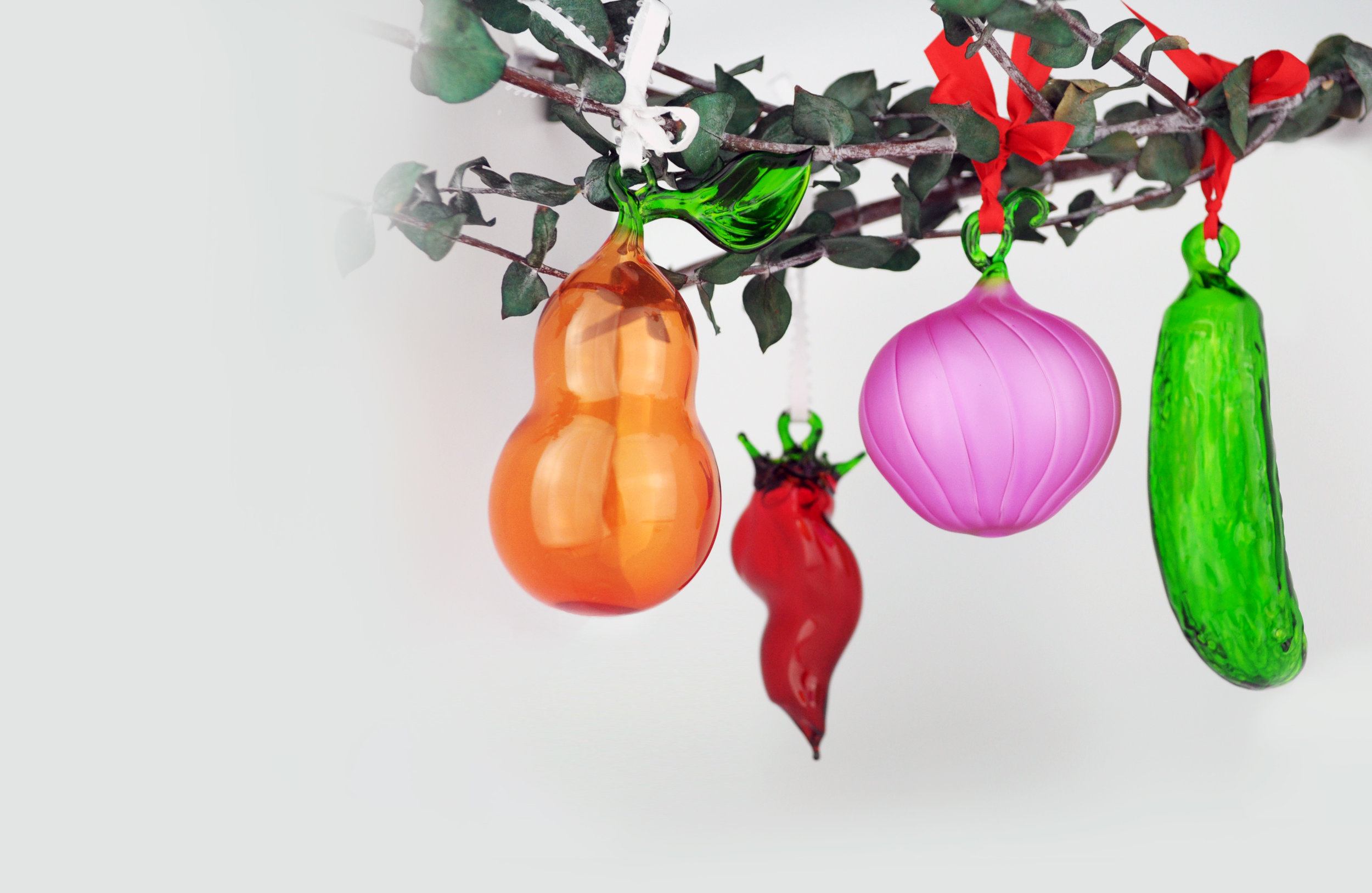 Contemporary Craft - Visit the shop at Contemporary Craft to find a variety of handcrafted items, like these glass vegetable ornaments.