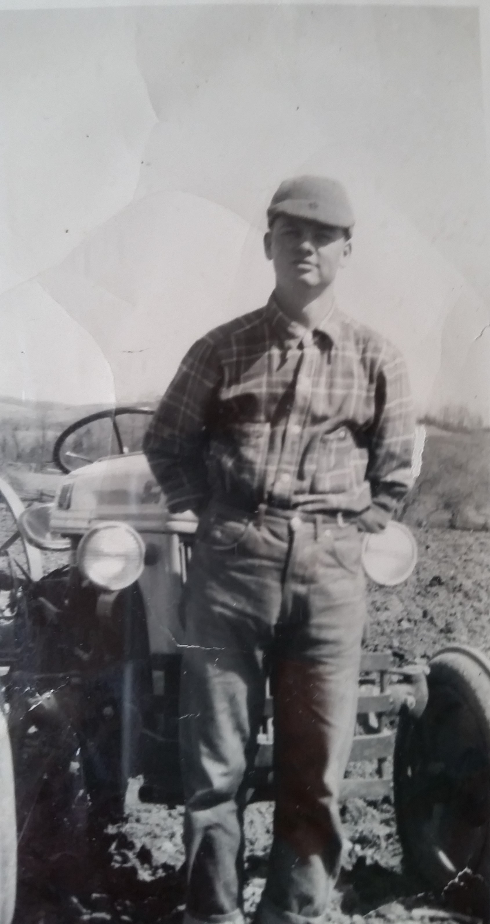 Dad Young with Tractor.jpg