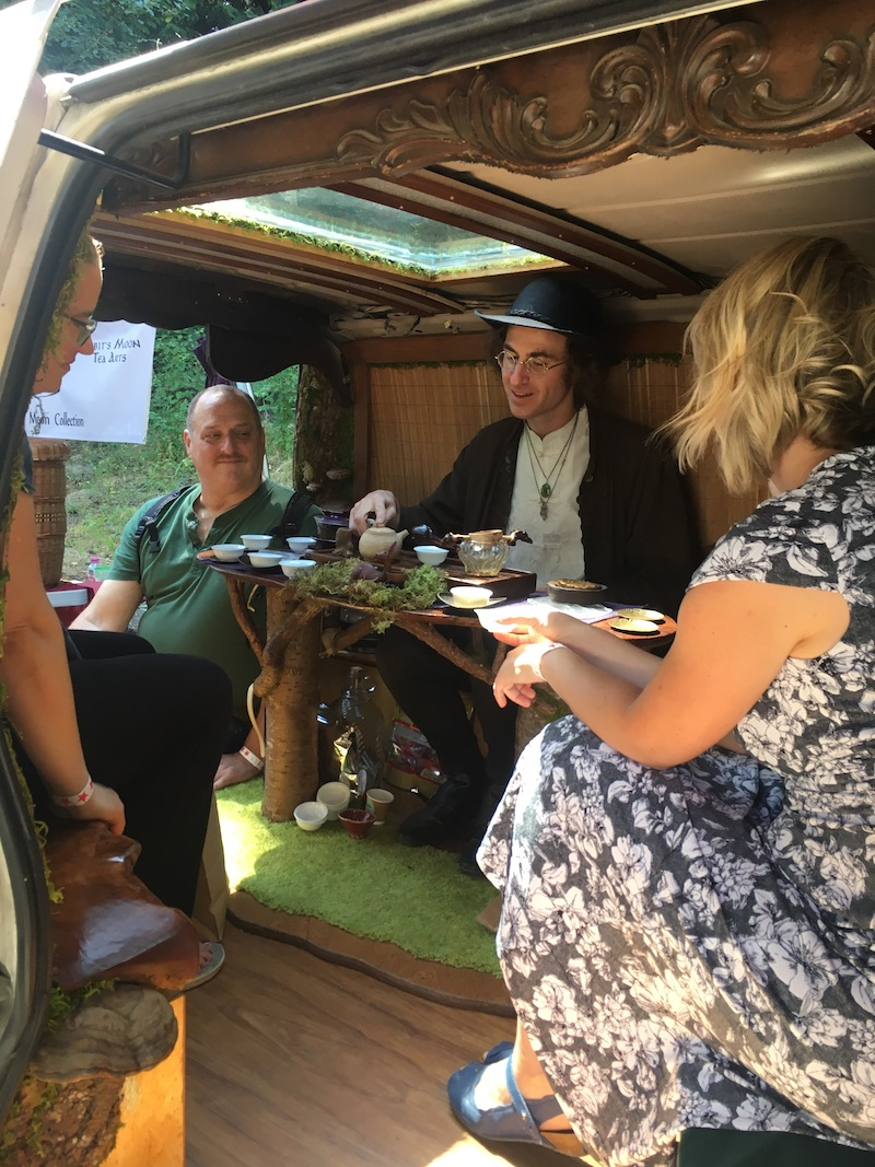 Steve Odell in his happy place entertaining a small group at his work-in-progress tea van.
