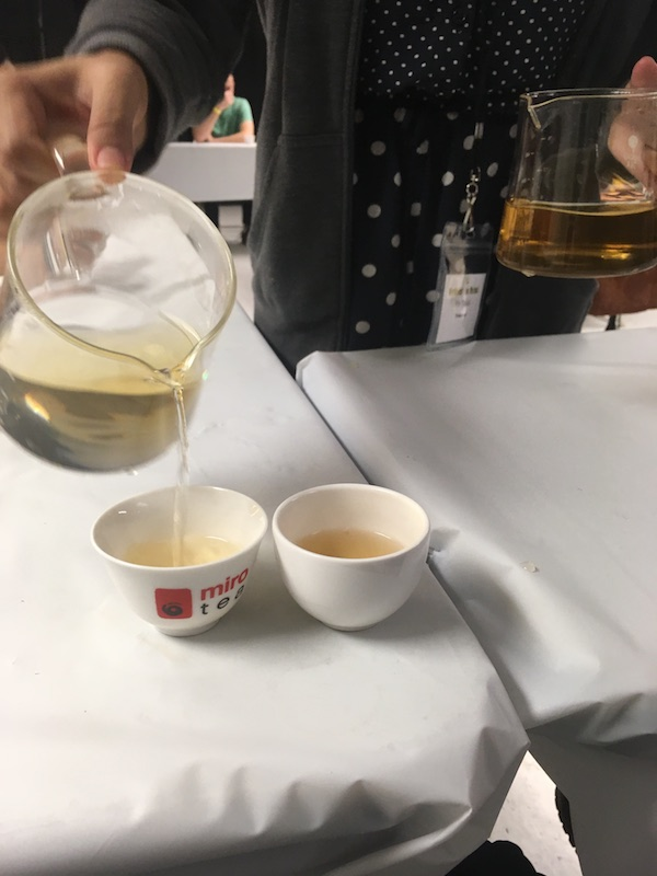 Rie Tulali (@teacurious) and I met at the World Tea Expo. She gives workshops at tea festivals around the US and at her home base in the Las Vegas metro area. Here, she is decanting the same green tea cupped for evaluation with two different kinds of water. The darker brewed tea (right) was brewed with Fuji bottled water which had nearly 150 TDS versus the local tap water at 38 TDS.