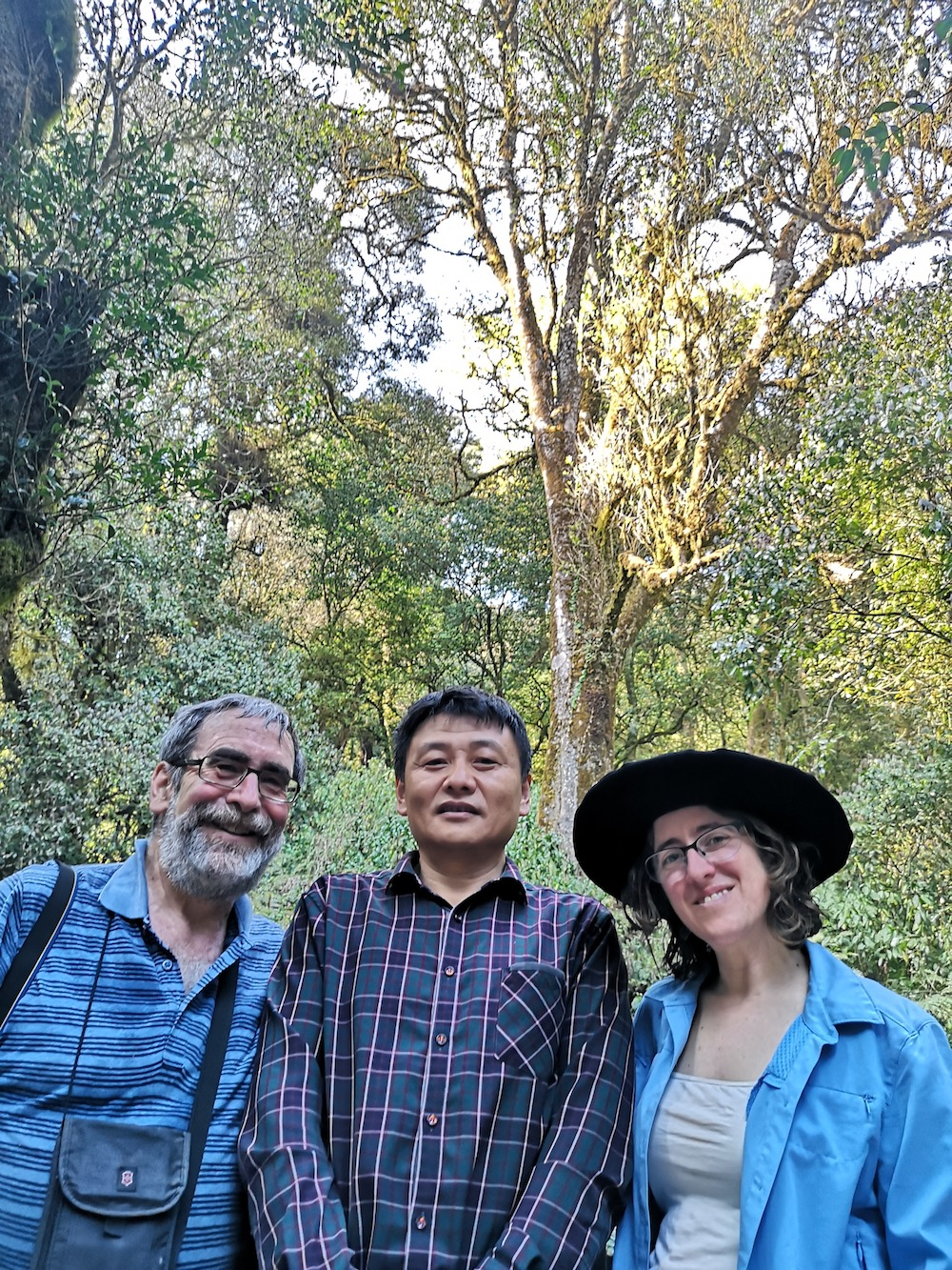Jack Joseph, Professor Hou, and I at the 2700 year old tea tree