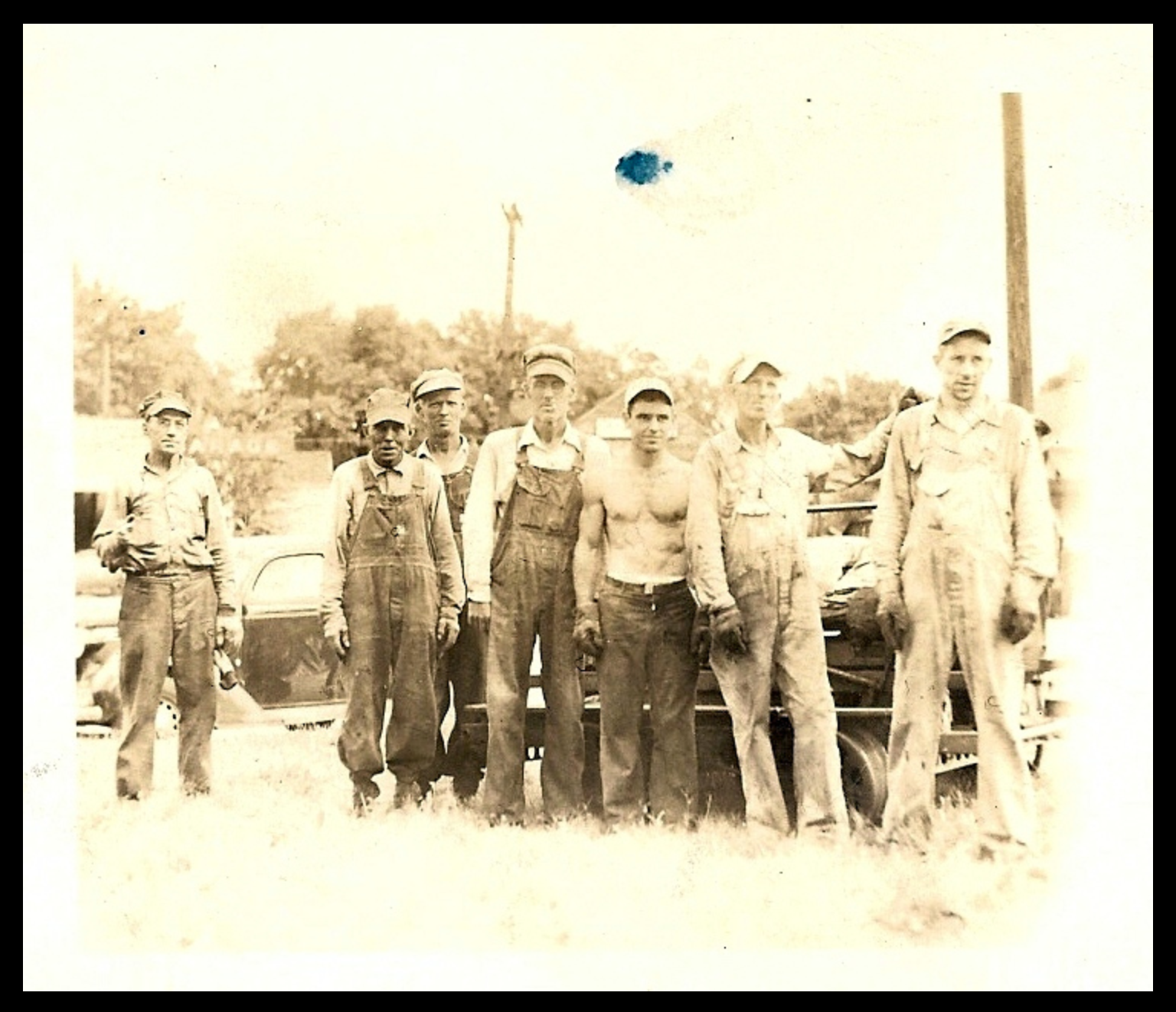 """My paternal grandfather Virgil Taylor Dennison with his """"Fan Club"""" - some of his extended family, friends, associates, and neighbors, circa 1946, Williamsville, IL, after a day's work on the Chicago & Alton Railroad section crew.  Left to right: Joe Parsons, brother-in-law; George Bensonhefer, neighbor & friend; Clyde Dennison, cousin; Grandpa; James Shinnebarger, nephew by marriage; Lewis Wheatley & Eldon Dambacher, sons-in-law."""