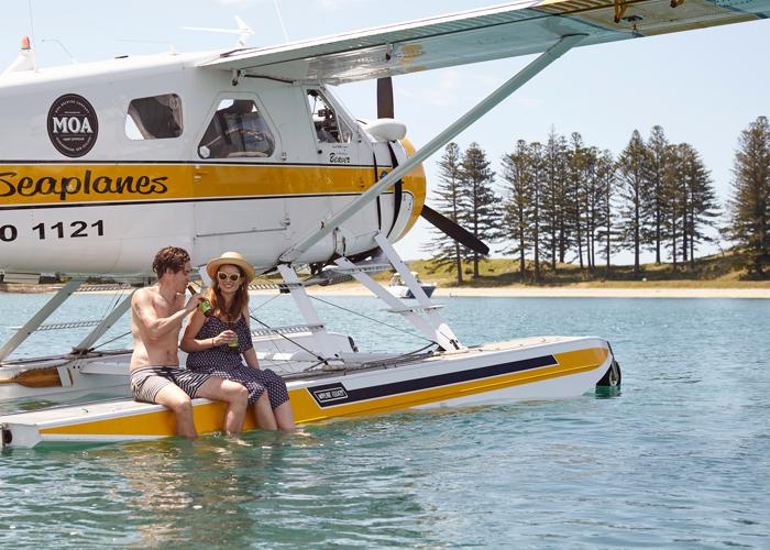 Honeymoon couple siting on sea plane at Maldives