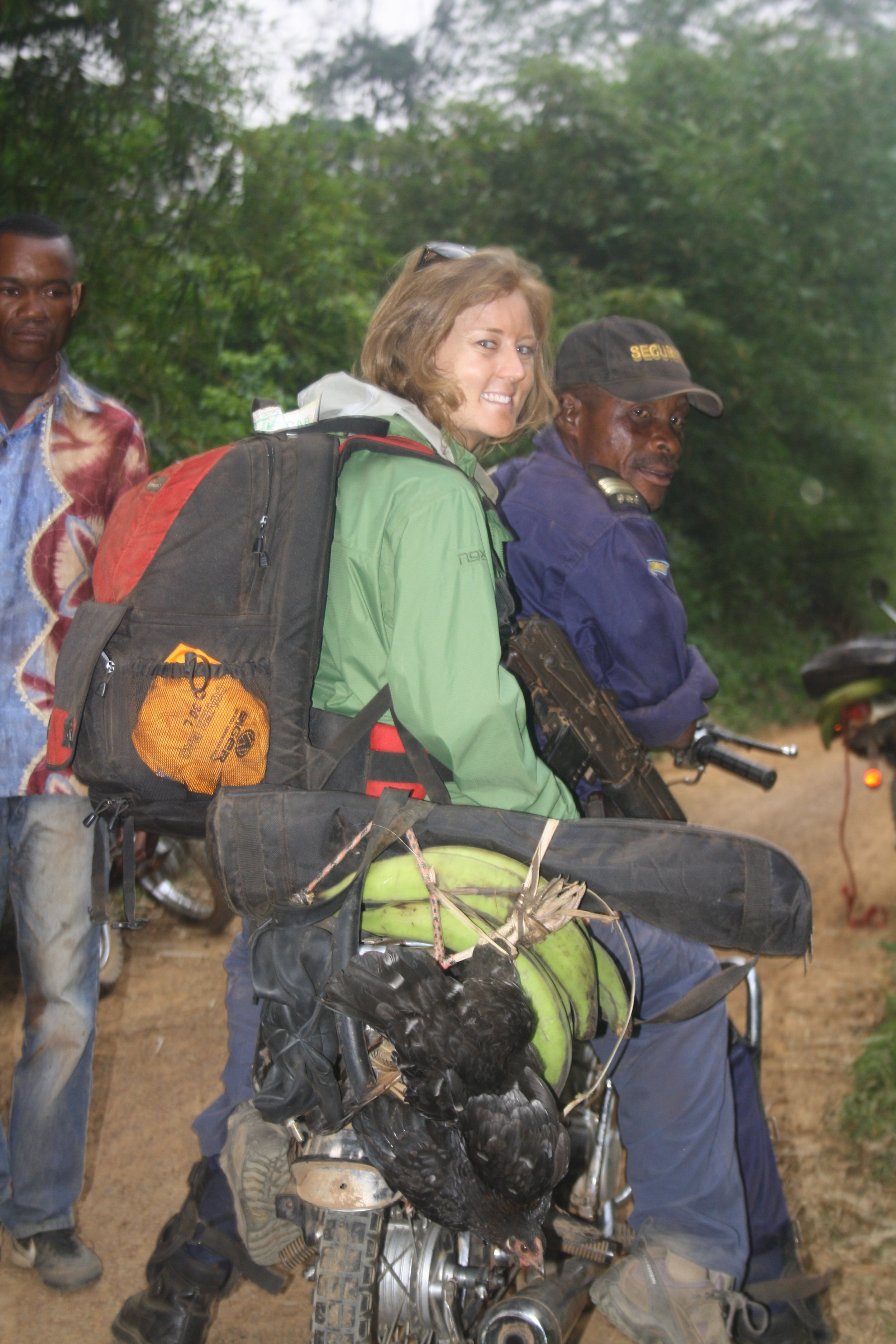 Heading into the forest in the Democratic Republic of Congo for CIFOR - that's my tripod between the AK47 and the chickens.