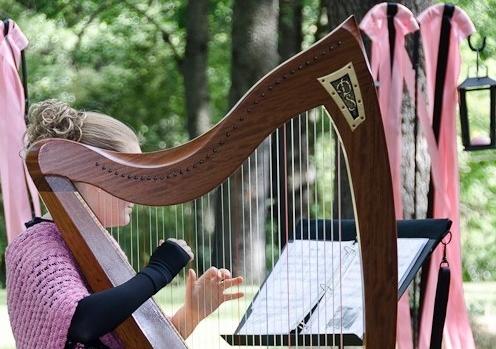 Stephanie playing harp at Jada's Wedding full shot.jpg