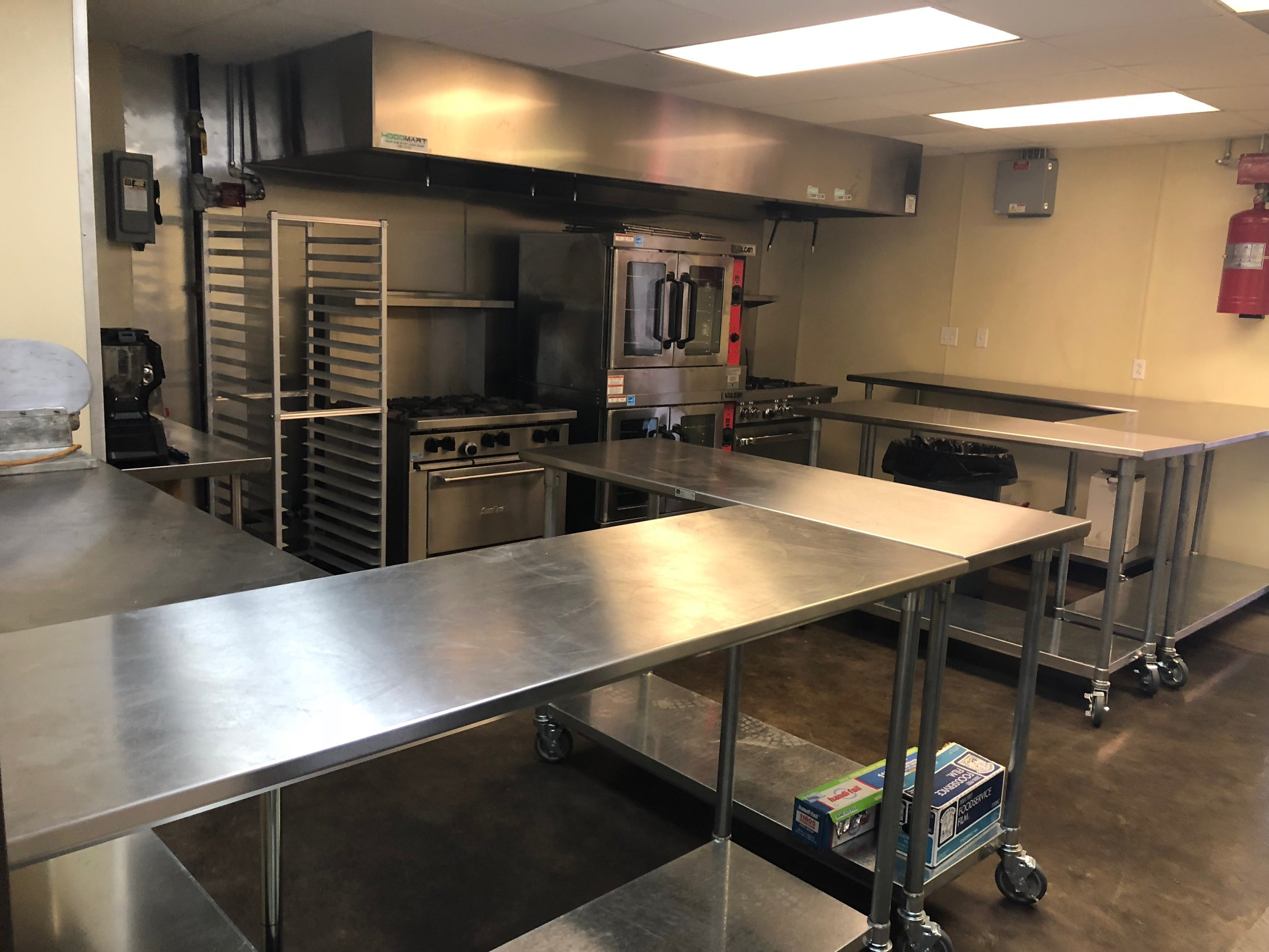 The Annex currently has a 1000 square foot shared use kitchen with 12 feet of hood space and a variety of equipment available